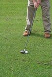 Postura del golf Foto de archivo libre de regalías