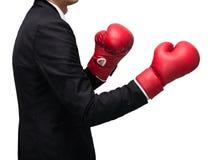 Postura derecha del hombre de negocios en guantes de boxeo Imágenes de archivo libres de regalías