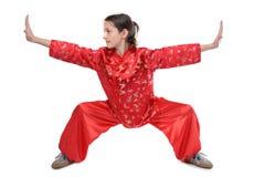 Postura inferior de la muchacha del fu de Kung Foto de archivo