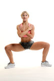 Posture accroupie de forme physique Photos libres de droits