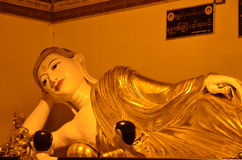 Posture of the Buddha in Reclining Buddha image at Shwedagon Pagoda. In the evening Stock Photo