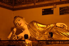 Posture of the Buddha in Reclining Buddha image at Shwedagon Pagoda. In the evening Royalty Free Stock Photos