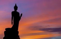 The Posture Of Walking Buddhist Statue In Twilight Silhouette Royalty Free Stock Images