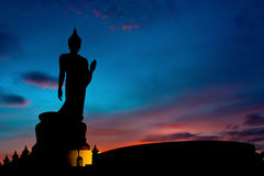 The Posture Of Walking Buddhist Statue In Twilight Silhouette Royalty Free Stock Photo