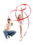 Postures accroupies de Breakdancer et hamming et fille gracieuse de gymnaste Images stock