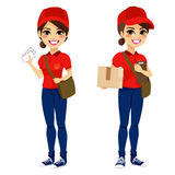 Postwoman Delivering Mail Parcel. Full body young post woman delivering mail and parcel with leather bag and folder wearing red uniform Stock Photo