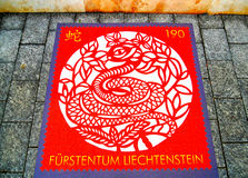 Postzegel met het beeld van slangen stock foto