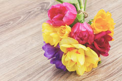 Posy  of spring flowers on wooden table Royalty Free Stock Image