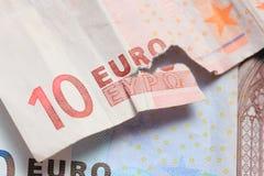 Poszarpana euro notatki i rocznika grka moneta Obraz Royalty Free