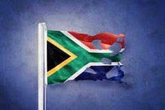 Poszarpana flaga Południowa Afryka latanie przeciw grunge tłu Obraz Stock
