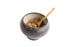 Pot. The cast-iron pot with spoon and boiled buckwheat isolated over white Stock Images