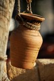A pot. Hung on the wood with a coir Royalty Free Stock Image