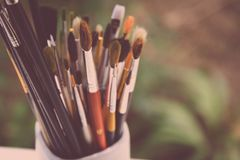 Pot of artist paint brushes Royalty Free Stock Photo