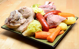 Pot-au-feu with meat and vegetables in a dish Stock Photos