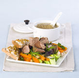 Pot-au-feu. With slices of bread on a plate with the broth in the background Stock Photography