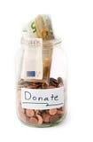 Pot avec l'argent de la donation photos stock