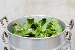 Pot of banana leaf cover bake. Thai steaming pot of banana leaf cover bake stock photo