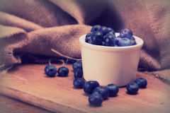 Pot of blueberries on a rustic background Royalty Free Stock Image