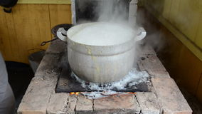 Pot boil rural furnace water run flow burn hand rise lid cover stock video