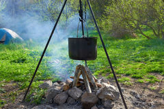 Pot boiling on the fire Royalty Free Stock Photography