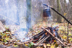 pot of boiling water heated on the fire in the camp Royalty Free Stock Image
