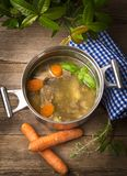 Pot with broth. Old Pot with fresh broth royalty free stock photos