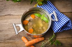 Pot with broth. Old Pot with fresh broth stock photos