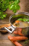 Pot with broth. Old Pot with fresh broth stock images
