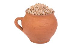 Pot with buckwheat porridge Royalty Free Stock Images