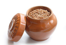 Pot with buckwheat porridge Royalty Free Stock Photo