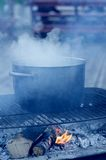 Pot on campfire. A pot cooking on a campfire royalty free stock photo