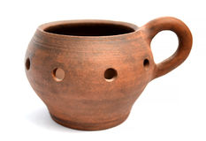 Pot / candle holder made ​​of clay on a white background Stock Image