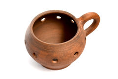 Pot / candle holder made ​​of clay on a white background Stock Images