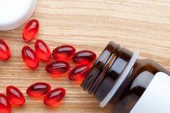 Pot of capsule pills Stock Image
