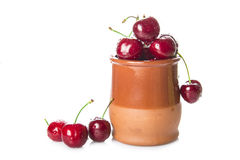 Pot with cherries isolated on a white background Royalty Free Stock Photo
