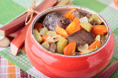 Pot with chicken liver, rhubarb and carrots Royalty Free Stock Images