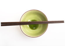 Pot and Chopsticks. On white background Royalty Free Stock Photography