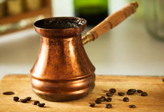 Pot of coffee with coffee beans Stock Photography