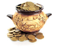 Pot & coins Royalty Free Stock Photography
