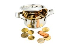 Pot with coins. A pressure cooker is filled with euro coins, symbolic photo for funding Royalty Free Stock Photos