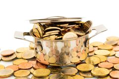 Pot with coins. A pressure cooker is filled with euro coins, symbolic photo for funding Royalty Free Stock Image