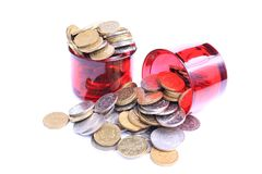 Pot of coins. 2 red glass filled with gold and silver coins overflowing from the top isolated on white background Stock Photography