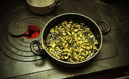 Pot with cooked zucchini in the ancient stove with fire lit Royalty Free Stock Images