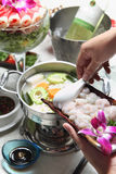 Pot cooking. Asia hot pot cooking and vegetarian wine Stock Images