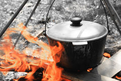 Pot for cooking on a fire Stock Photos