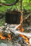 Pot for cooking on a fire in a campaign Stock Photos
