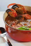 Pot of crab cioppino with crab claws Royalty Free Stock Photo