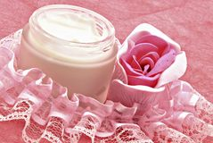 Pot of cream with a rose Royalty Free Stock Images