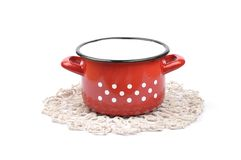 Pot on crochet doily Stock Photo
