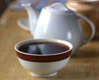 Pot and cup of fresh tea Stock Images